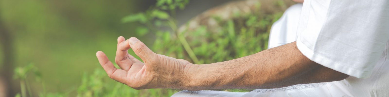 A close up picture of hands doing meditation